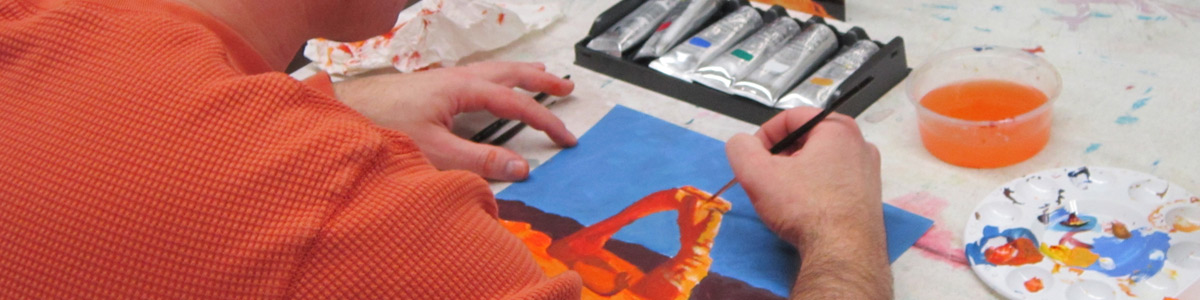 An Acrylic Painting student works on a painting