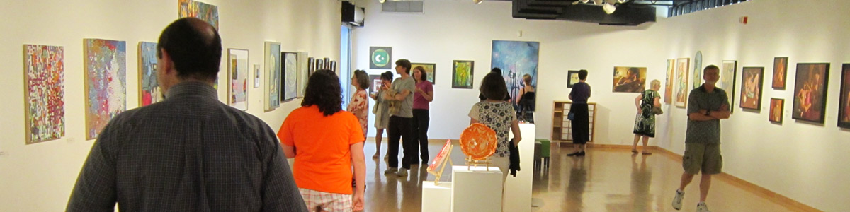 Reception guests explore the 2012 Resident Visual Artists Exhibit
