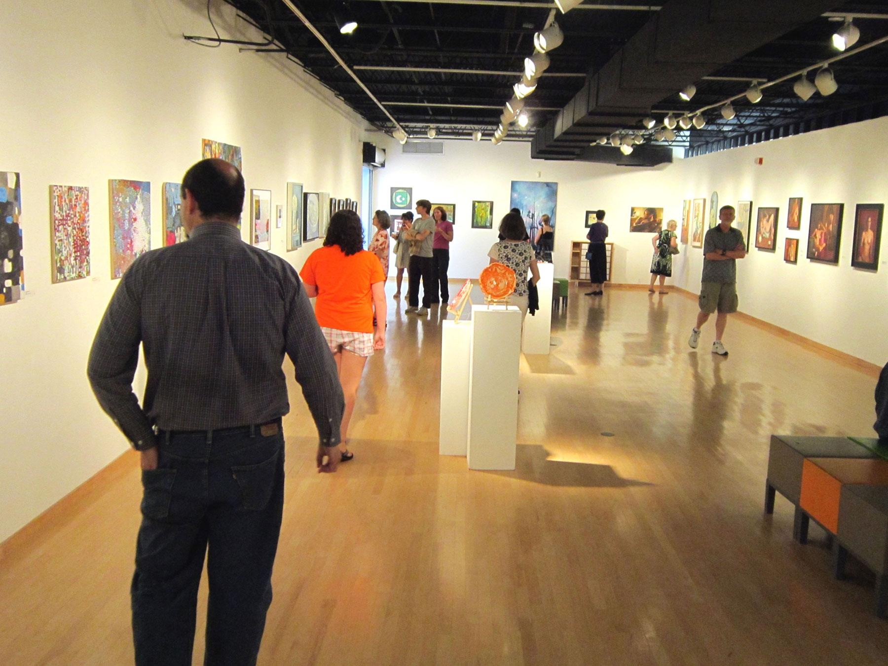 Reception guests explore the 2014 Resident Visual Artists Exhibit