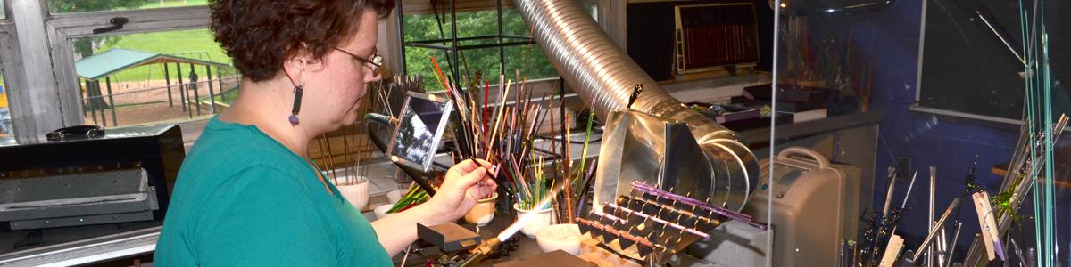 HCAC Resident Artist Alice St. Germain-Gray demonstrates flameworking (photo: Sara Weithoner)