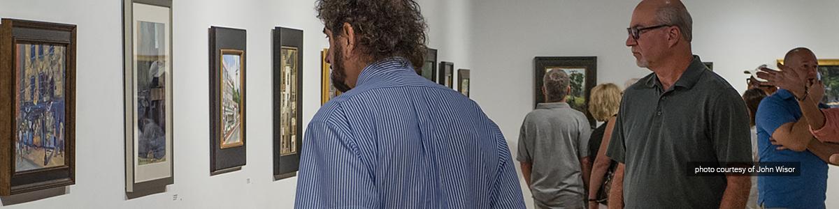 Reception guests explore the Paint It! Ellicott City 2016 exhibit