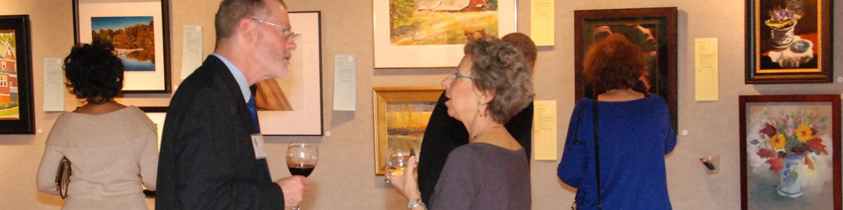 Celebration guests explore the Silent Auction