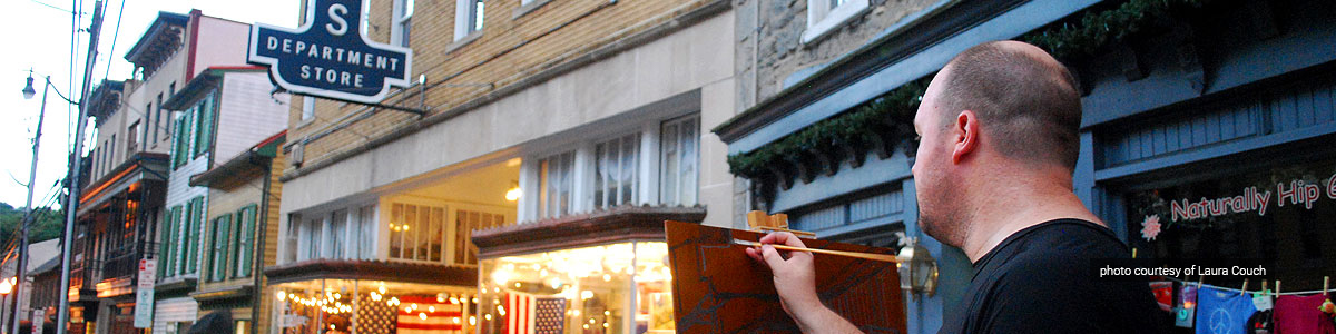 Artist Alex Wissel paints on Ellicott City's Main Street