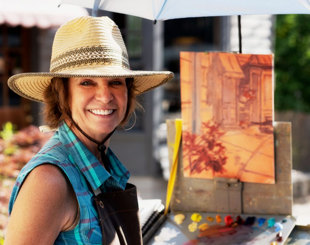 Artist Carol Cowie takes part in Paint It! Ellicott City 2019 (Photo: Ray Urena)